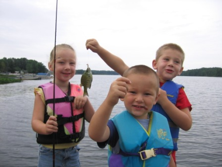 Kailey, Landon, and Corbin enjoy the fishing from the dock at Rainbow Bay Resort on Benoit Lake, July 2012.