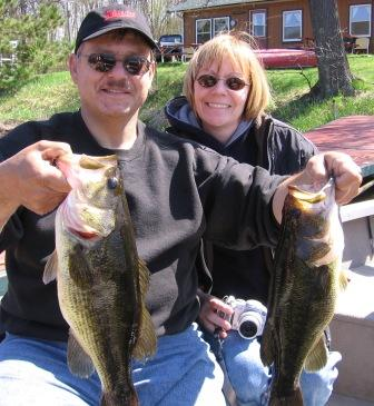 Martin and Deanna V. with 19 and 16 inch bass that they caught and released on Benoit Lake, May 2008.
